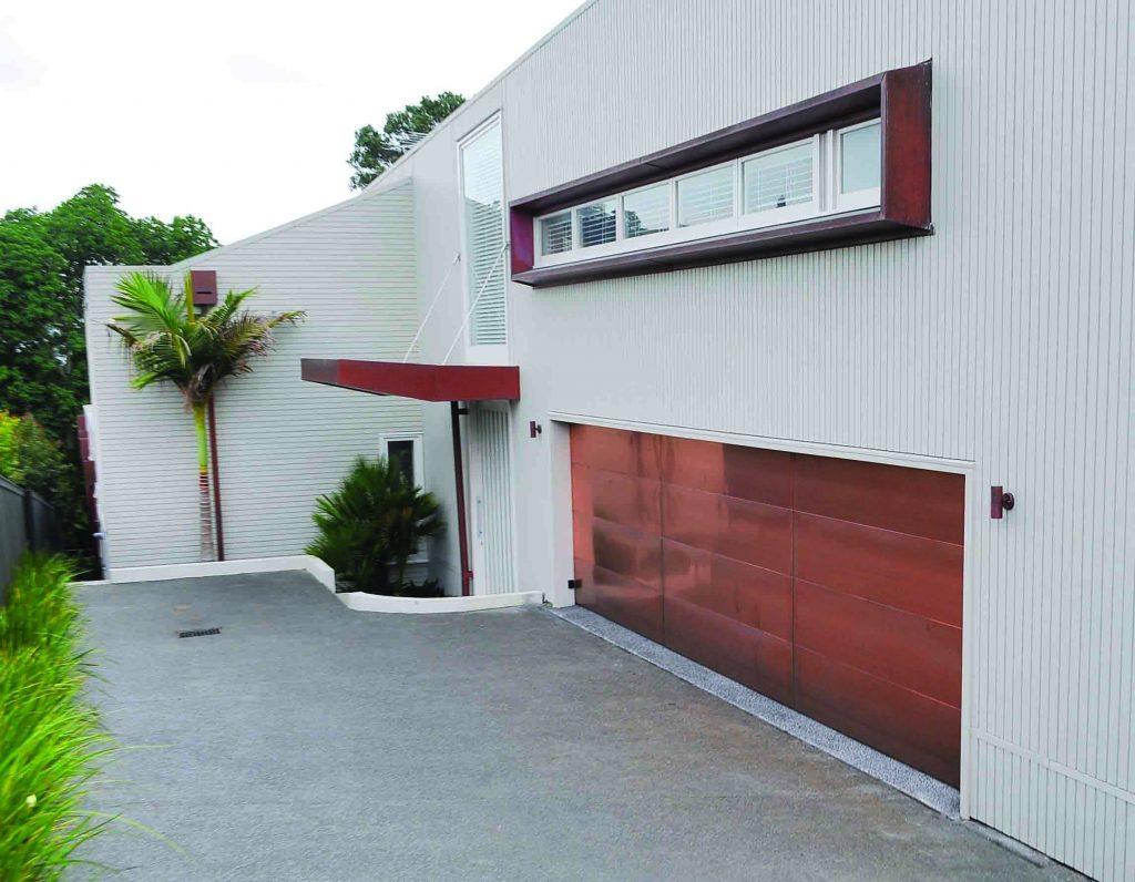 Prestige doors customized cladding for Cedar clad garage doors